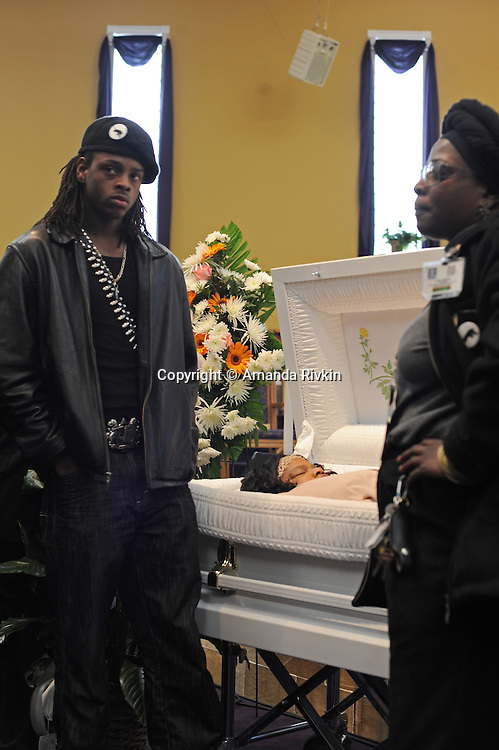 Friends and fellow activists pay their respects at the funeral of housing activist Beauty Turner, 51, a one-time resident of the Robert Taylor Homes who led the Beauty Turner Ghetto Bus Tour and received national recognition in publications such as The Wall Street Journal, at the Greater Harvest Missionary Baptist Church on South State Street in Chicago, Illinois on December 26, 2008.  Turner died of an aneurysm on December 18.