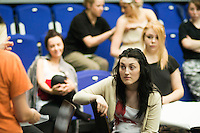 """""""Fame, Faust & Flying Colours"""", following a musical theatre rehearsal, the students and director discuss notes.  Further Education College."""