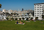 California: San Francisco. People relaxing in Alamo Square with view of Victorians and modern downtown. Photo copyright Lee Foster. Photo #: san-francisco-alamo-square-20-casanf79076