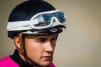 BALTIMORE, MD - MAY 19: Jockey Nik Juarez atop Acrtress #10 (black hat), during the post parade, in pouring rain, for the Black Eyes Susan Stakes, in which he will eventually win on Black-Eyed Susan Day at Pimlico Race Course on May 19, 2017 in Baltimore, Maryland.(Photo by Douglas DeFelice/Eclipse Sportswire/Getty Images)