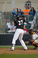 Micker Adolfo (27) of the Kannapolis Intimidators at bat against the Delmarva Shorebirds at Kannapolis Intimidators Stadium on April 23, 2016 in Kannapolis, North Carolina.  The Shorebirds defeated the Intimidators 4-2.  (Brian Westerholt/Four Seam Images)