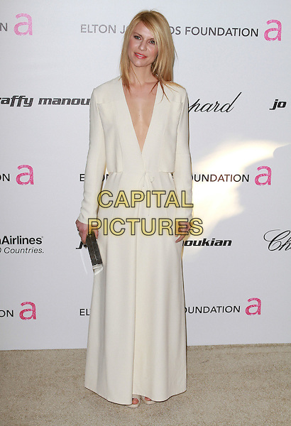 CLAIRE DANES.The 19th Annual Elton John AIDS Foundation Academy Awards Viewing Party held at The Pacific Design Center Outdoor Plaza in West Hollywood, California, USA, February 27th 2011..oscars full length white cream long sleeve maxi v-neck clutch bag .CAP/ADM/FS.©Faye Sadou/AdMedia/Capital Pictures.