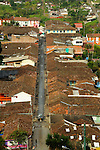 From the mountain top, the rooftops in Salento, Colombia seems to almost be continuous.  A view of the main shopping street.The rooftops of Salento, in the highlands of Colombia......
