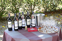 bottles of wine and glasses of tasting outside chateau le bourdillot graves bordeaux france