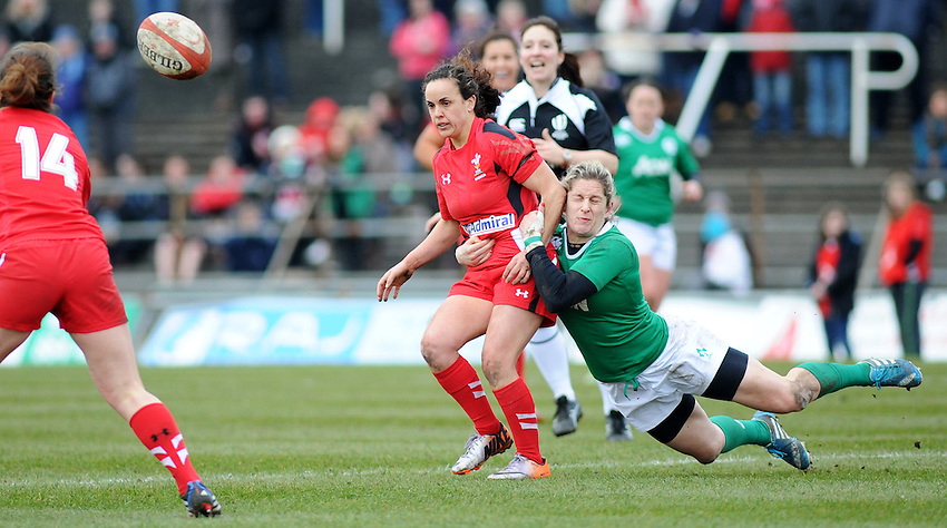 Wales&rsquo; Amy Day offloads the ball before being tackled by Ireland&rsquo;s Alison Miller <br /> <br /> Photographer Kevin Barnes/CameraSport<br /> <br /> International Womens Rugby Union - 2015 Women&rsquo;s RBS Six Nations - Wales Women v Ireland Women - Sunday 15th March 2015 - St Helen's - Swansea<br /> <br /> &copy; CameraSport - 43 Linden Ave. Countesthorpe. Leicester. England. LE8 5PG - Tel: +44 (0) 116 277 4147 - admin@camerasport.com - www.camerasport.com