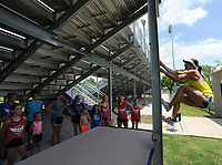 NWA Democrat-Gazette/ANDY SHUPE<br /> April Steiner Bennett, a former Arkansas and Olympic pole vaulter, climbs to the top of an I-beam Friday, June 16, 2017, at Ramay Junior High School in Fayetteville. Steiner Bennett competed in the ninth season of American Ninja Warrior.