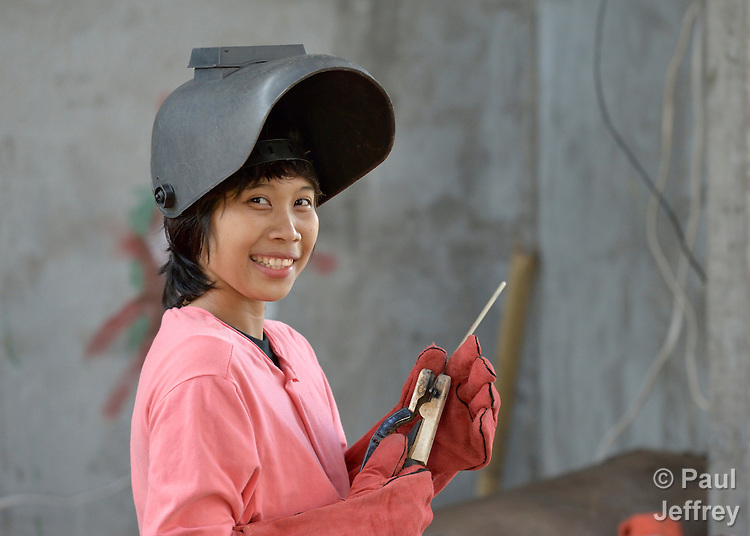 Jeddah Palo participates in a welding course at the San Roque Catholic Church in Tolosa, a small town in the Philippines that was devastated by Typhoon Haiyan in 2013. Palo, 24, lost her home to the typhoon's storm surge and has been living with her mother. The 25-day welding course, sponsored by Catholic Relief Services, provides her with training for a new livelihood, while students put their newfound skills to work rebuilding the church's collapsed sanctuary. The storm was known locally as Typhoon Yolanda.