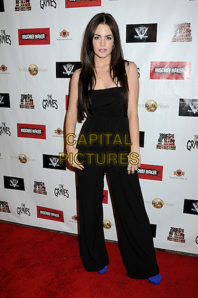 "JILLIAN MURRAY.""The Graves"" Los Angeles Premiere held at Mann's Beverly Center 13 Cinemas, Los Angeles, California, USA, .30th January 2010..full length black strapless catsuit jumpsuit blue shoes Claire .CAP/ADM/BP.©Byron Purvis/Admedia/Capital Pictures"
