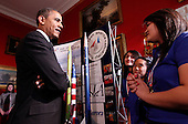 United States President Barack Obama talks with Ana Nieto (R) of Presidio, Texas, team leader of Team America Rocketry Challenge (TARC) along with teammates Janet Nieto (3nd R) and and Gwynelle Condino (2nd R) while touring student science fair projects on exhibt at the White House in Washington, D.C. on February 7, 2012.  Obama hosted the second White House Science Fair celebrating the student winners of science, technology, engineering and math (STEM) competitions from across the country..Credit: Molly Riley / Pool via CNP