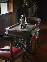 This table was placed next to the window in the large dining room in Robert Louis Stevenson's home in Vailima, Western Samoa.  Since light was at a premium, Stevenson and his wife would often use this table to take their tea or to read.
