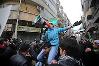 Photographer: Rick Findler/Borderline News..18.01.13 A young boy leads the chants at an anti-Assad rally after Friday prayers in the heart of Aleppo, Northern Syria.