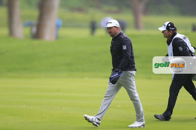 Graeme McDowell (NIR) and caddy Ken Comboy on the 17th hole during Friday's Round 2 of the 2017 Genesis Open held at The Riviera Country Club, Los Angeles, California, USA. 17th February 2017.<br /> Picture: Eoin Clarke | Golffile<br /> <br /> <br /> All photos usage must carry mandatory copyright credit (&copy; Golffile | Eoin Clarke)