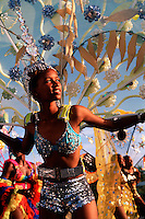 A young girl in costume dances during a carnival. St. Maarten.