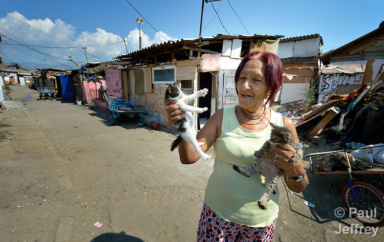A woman plays with cats in the street in front of her house in Suto Orizari, Macedonia. The mostly Roma community, located just outside Skopje, is Europe's largest Roma settlement. .
