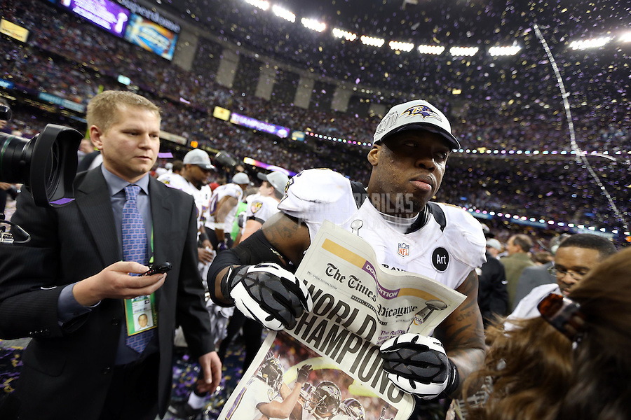 Feb 3, 2013; New Orleans, LA, USA; Baltimore Ravens outside linebacker Terrell Suggs holds a newspaper after defeating the San Francisco 49ers in Super Bowl XLVII at the Mercedes-Benz Superdome. Mandatory Credit: Mark J. Rebilas-