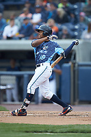 Jose Azocar (18) of the West Michigan Whitecaps follows through on his swing against the South Bend Cubs at Fifth Third Ballpark on June 10, 2018 in Comstock Park, Michigan. The Cubs defeated the Whitecaps 5-4.  (Brian Westerholt/Four Seam Images)