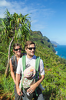 Two hikers with their baby on the Kalalau Trail on Kaua'i.
