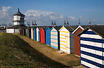 Colourful seaside beach huts and Low lighthouse maritime museum, Harwich, Essex, England