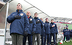 Bruce Arena (l), head coach of the United States, stands at attention during the playing of the national anthem with his coaching staff including assistants (from left) Glenn Myernick, Curt Onalfo, and Milutin Soskic on Sunday, February 19th, 2005 at Pizza Hut Park in Frisco, Texas. The United States Men's National Team defeated Guatemala 4-0 in a men's international friendly.