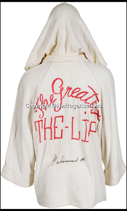 BNPS.co.uk (01202 558833)<br /> Pic: Heritage Auctions/BNPS<br /> <br /> A signed robe worn by a young Muhammad Ali as he entered the ring to face heavyweight titan Sonny Liston in what turned out to be one of the greatest ever sporting upsets has emerged for sale for &pound;150,000.<br /> <br /> Ali, then aged 22 and still known as Cassius Clay, was the clear underdog as he stepped over the ropes to face world champion Liston in Miami on February 25 1964. <br /> <br /> But despite the odds weighing heavily against Ali, the rising star displayed his trademark confidence when he emerged wearing a white robe embroidered with the words 'The Lip', a nod to his nickname The Louiseville Lip.<br /> <br /> The match was handed to Ali when Liston, clearly beaten, refused to come out for the seventh round.<br /> <br /> The robe has been tipped to fetch a staggering $200,000 - around &pound;150,000 - when it goes under the hammer at Heritage Auctions in Dallas, Texas.