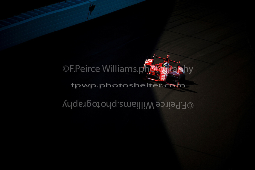 "Dario Franchitti (#50) runs practice laps in the fading light of ""Happy Hour"". (Indy 500 Practice Day)"