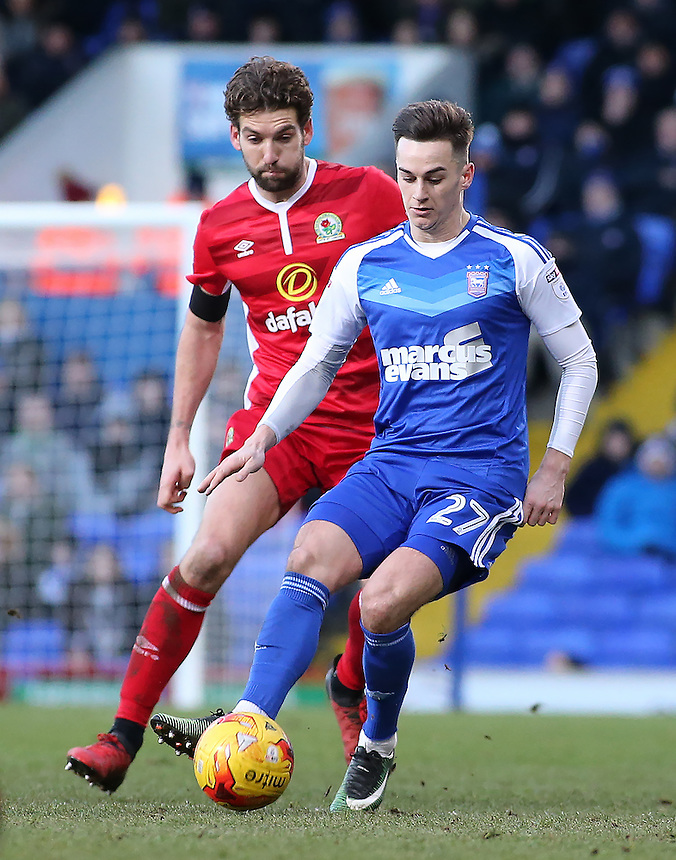 Ipswich Town's Tom Lawrence is chased down by Blackburn Rovers' Charlie Mulgrew<br /> <br /> Photographer David Shipman/CameraSport<br /> <br /> The EFL Sky Bet Championship - Ipswich Town v Blackburn Rovers - Saturday 14th January 2017 - Portman Road - Ipswich<br /> <br /> World Copyright &copy; 2017 CameraSport. All rights reserved. 43 Linden Ave. Countesthorpe. Leicester. England. LE8 5PG - Tel: +44 (0) 116 277 4147 - admin@camerasport.com - www.camerasport.com