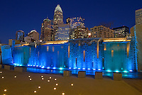 Romare Bearden Park  - The Charlotte NC skyline rises up out of the Romare Bearden Park in Uptown Charlotte&rsquo;s Third Ward .Buildings shown in photo include the  Wells Fargo buildings (middle), Bank of America tower and Hearst Tower. Romare Bearden Park is a 5.4-acre public park located at 300 S. Church Street in Charlotte, North Carolina.<br /> Charlotte Photographer - PatrickSchneiderPhoto.com