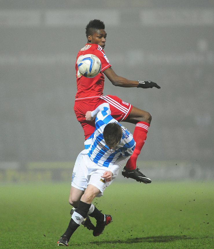Middlesbrough's Sammy Ameobi vies for possession with Huddersfield Town's Paul Dixon ..Football - npower Football League Championship - Huddersfield Town v Middlesbrough - Tuesday 05th March 2013 - John Smith's Stadium - Huddersfield..¨© CameraSport - 43 Linden Ave. Countesthorpe. Leicester. England. LE8 5PG - Tel: +44 (0) 116 277 4147 - admin@camerasport.com - www.camerasport.com