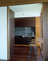 The contemporary kitchen incorporates texture and a variety of wood and other materials in its functional design