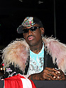 Coach Dennis Rodman  attends the press conference for HQ's strippers basketball team in New York, on Thursday, Mar. 01, 2012. (AP Photo/ Donald Traill)