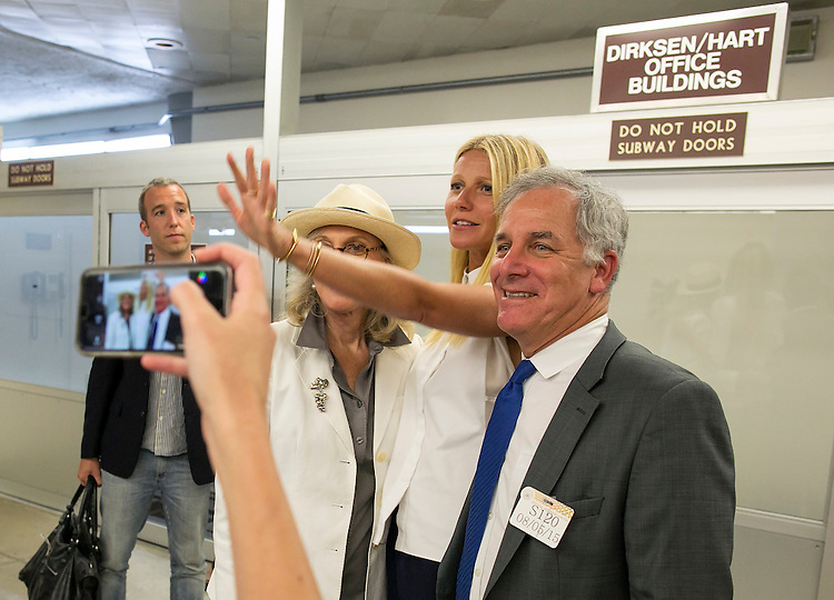 UNITED STATES - August 5: Actress Gwyneth Paltrow yells at photographers to give her privacy as she has her photo taken with her mother, Blythe Danner, left, and Gary Hirshberg, Chairman of Stonyfield Organic, right, in the Senate Subway in the basement of the Capitol, Wednesday, August 5, 2015. (Photo By Al Drago/CQ Roll Call)