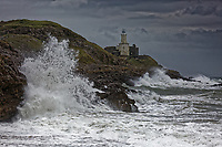 2018 09 20 Waves crash against rocks by Mumbles Lighthouse, Wales, UK