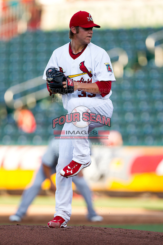 Michael Blazek (33) of the Springfield Cardinals winds up during a game against the Tulsa Drillers at Hammons Field on July 19, 2011 in Springfield, Missouri. Tulsa defeated Springfield 17-11. (David Welker / Four Seam Images)