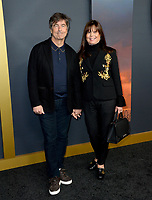 "LOS ANGELES, USA. December 19, 2019: Thomas Newman & Anne Marie Zirbes at the premiere of ""1917"" at the TCL Chinese Theatre.<br /> Picture: Paul Smith/Featureflash"