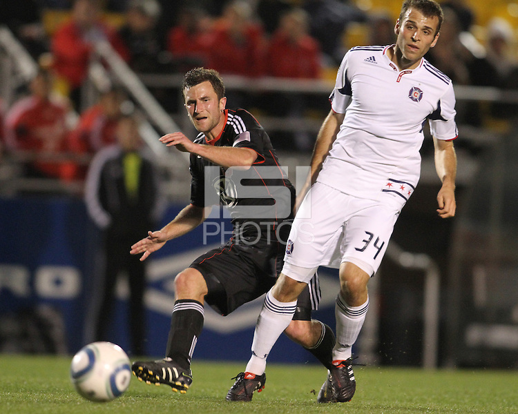 Stephen King#7 of D.C. United gets the ball away from Mike Videira #34 of the Chicago Fire during a second round match of the Carolina Challenge on March 9 2011 at Blackbaud Stadium, in Charleston, South Carolina. D.C. United won 1-0.