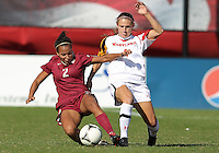 COLLEGE PARK, MD - OCTOBER 21, 2012:  Cory Ryan (4) of the University of Maryland tackles Ines Jaurena (2) of Florida State during an ACC women's match at Ludwig Field in College Park, MD. on October 21. Florida won 1-0.