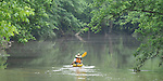 A kayaker paddles down the Patuxent River at the Governors Bridge Road crossing.
