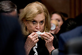 Rep. Carolyn Maloney (D-N.Y.) becomes emotional while listening to Christine Blasey Ford testify before the Senate Judiciary Committee on Capitol Hill in Washington, Thursday, Sept. 27, 2018. (AP Photo/Andrew Harnik, Pool)