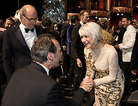 Oscar&reg;-winner Alexandre Desplat greets Helen Mirren during the live ABC Telecast of the 90th Oscars&reg; at the Dolby&reg; Theatre in Hollywood, CA on Sunday, March 4, 2018.<br /> *Editorial Use Only*<br /> CAP/PLF/AMPAS<br /> Supplied by Capital Pictures
