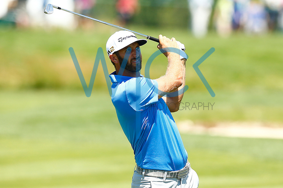 Dustin Johnson watches his second shot on the 18th fairwayduring the 2016 U.S. Open in Oakmont, Pennsylvania on June 17, 2016. (Photo by Jared Wickerham / DKPS)