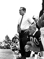 Al Davis coaching the Raiders at Frank Youell field in downtown Oakland. Center Jim tto kneels next..1963 photo copyright Ron Riesterer/Oakland Tribune.