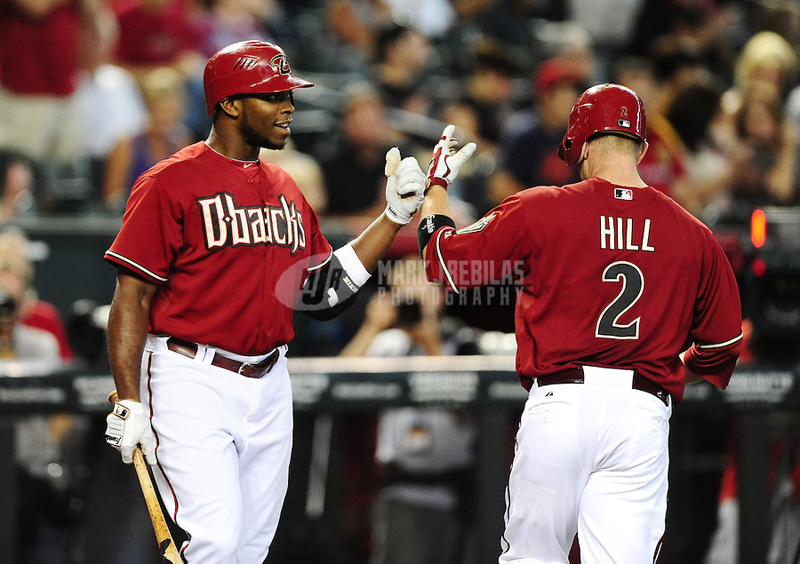 Jun. 20, 2012; Phoenix, AZ, USA; Arizona Diamondbacks infielder Aaron Hill (right) is congratulated by Justin Upton after hitting a solo home run in the first inning against the Seattle Mariners at Chase Field.  Mandatory Credit: Mark J. Rebilas-