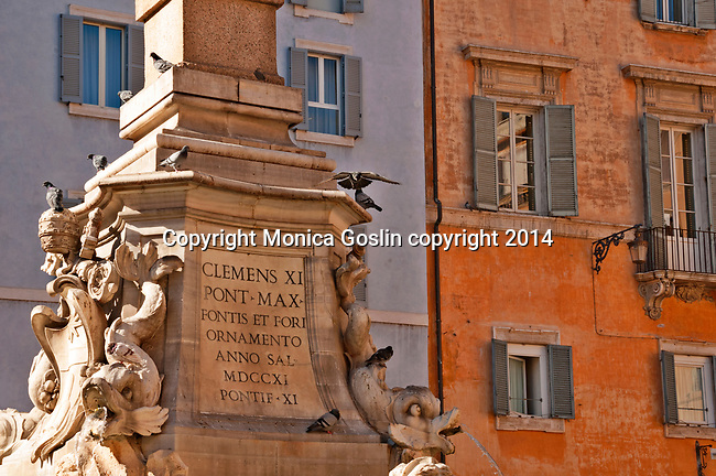 Detail of the Fontana del Pantheon and colorful buildings in front of the Pantheon in Rome, Italy