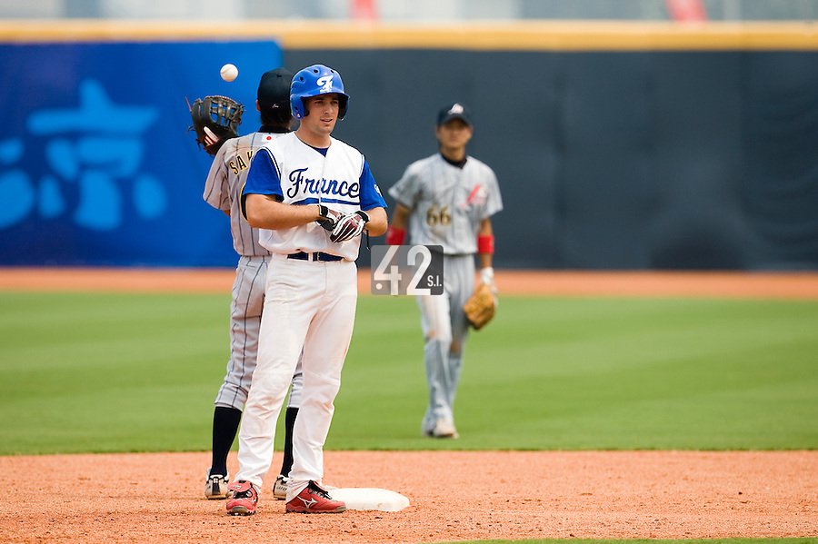 19 August 2007: #24 Gaspard Fessy advances to the second base on a double during the Japan 4-3 victory over France in the Good Luck Beijing International baseball tournament (olympic test event) at the Wukesong Baseball Field in Beijing, China.