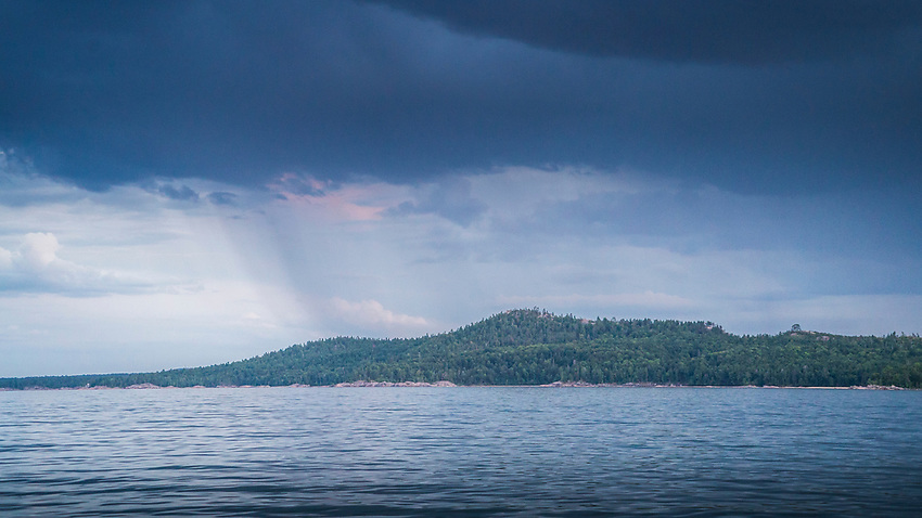 Rainshower over Sugarloaf Mountain and Lake Superior near Marquette, Michigan.