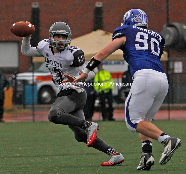 Darien, CT-120614MK10 Naugatuck's  Jason Bradley (13) avoids pressure from Darien's Mark Evanchick (90) during the CIAC Class L Large semi-final game at Darien High School Saturday afternoon. Darien defeated Naugatuck 42-12. Michael Kabelka / Republican-American