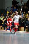 Mannheim, Germany, January 24: During the 1. Bundesliga Damen Hallensaison 2014/15 quarter-final hockey match between Mannheimer HC (white) and Harvestehuder THC (black) on January 24, 2015 at Irma-Roechling-Halle in Mannheim, Germany. Final score 2-3 (2-2). (Photo by Dirk Markgraf / www.265-images.com) *** Local caption *** Nike Lorenz #16 of Mannheimer HC