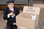 A young boy holding a FREE kitten