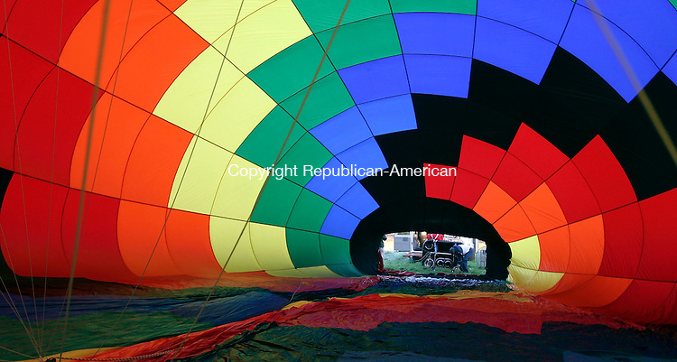 MIDDLEBURY, CT-10October 2006-101006TK03- As hot air is forced into the balloon, it slowly forms into the giant hot air balloon that will glide over the hills of Middlebury.  Tom Kabelka Republican-American (Middlebury Bicentennial Celebration)