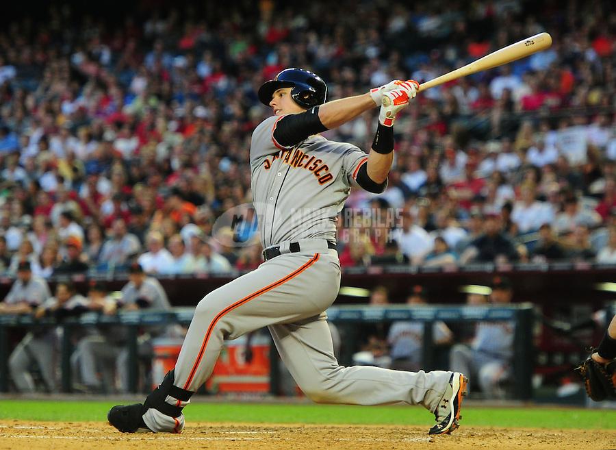 May 12, 2012; Phoenix, AZ, USA; San Francisco Giants catcher Buster Posey at bat against the Arizona Diamondbacks at Chase Field. Mandatory Credit: Mark J. Rebilas-